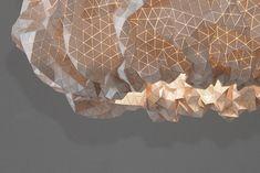 Wood triangles into textile fabric pendant light lampshade, via @design-milk