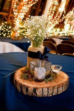 Blue Wedding Flowers centerpiece from our wedding navy blue mason jars filled with babys breath votives and moss Wedding Centerpieces Mason Jars, Mason Jar Centerpieces, Centerpiece Ideas, Western Wedding Centerpieces, Photo Centerpieces, Burlap Wedding Centerpieces, Wood Slice Centerpiece, Blue Wedding Decorations, Vintage Decorations