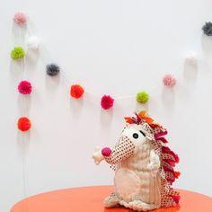 Create your own mini pom pom garland.