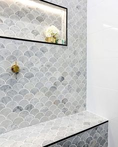 fish scale tile as art wall, framed shampoo niche
