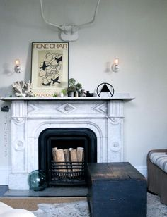 Great fireplace! ~ETS (An Eclectic Rental In A Second Empire Home | Design*Sponge)