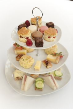 Afternoon Tea - A selection of finger sandwiches, Cheese & Chive Scones, Vol-Au-Vents filled with Chicken and Mushrooms, Scones with Whipped Cream Jam & Strawberries, Brownie Bites, Lemon Tart Bars, Panna Cotta and Macarons.