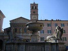 Fountain of S Maria in Trastevere. Attested already in the 15th century was restored by Bernini for Alexander VII Chigi. He added 4 double shells. In modern time the inscription inside the shells SPQR