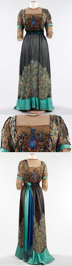 """In this gown, by the little-known Parisian House of Weeks, both printed and embroidered peacock motifs enliven the skirt and bodice. The metallic threads of the embroidery add a shimmery quality to the bodice, while the blue and green colors of the birds are picked up in the sash, sleeve ends, and hem band."" 