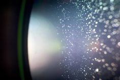 From particles to microscope lens?