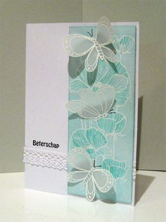 Delicate Blossoms white embossed with soft aqua...delicate white, dimensional, vellum butterflies...delightful!!