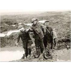 Canadian soldier with German prisoners. WW1 Passchendaele