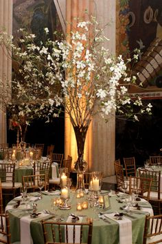Don't like the tall centerpiece but I like the simple napkin and the clean look of the table