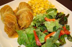 Mennonite Girls Can Cook: Holubschi (cabbage rolls) Rolls / No canned soup!  Filling:  1 head Savoy cabbage  1 lb lean ground beef  1 tsp salt  pepper  1/2 grated onion  1/2 cup sour cream  1 – 1 1/2 cup cooked rice  Sauce:  ½ chopped onion  ½ chopped pepper, any color  4 Tbsp flour  4 c water (approx)  1 bouillon cube (Knorr chicken)  3 Tbsp tomato paste ( or acc. to taste)  salt and pepper, to taste