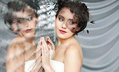 birdcage veil; mirror; mischievous look; interesting texture/color behind