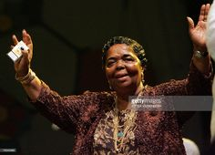 Cape Verde singer Cesaria Evora welcomes her fans on the 'Main stage', 09 August 2007 on the second evening of the Sziget festival, one of the biggest and most eclectic events on the European music calendar, on Hajogyar (Shipyard) Island in Budapest, Hungary. AFP PHOTO / ATTILA KISBENEDEK