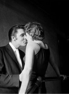"""""""The Kiss"""" by Alfred Wertheimer - Elvis Presley and a flirtatious young fan on a backstage staircase at the Mosque Theater in Richmond, Virginia, July 1956 - The Kiss, Elvis Presley, Gq, Historia Do Rock, Kiss Concert, Rock And Roll History, Barbara Gray, Nostalgia, Young Elvis"""