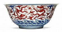 A RARE AND LARGE IRON-RED AND BLUE 'DRAGON' BOWL<BR>JIAJING MARK AND PERIOD |