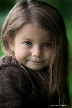The best Kid photos are close ups that capture them in a natural pose. This one is so cute.