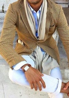 Mustard tweed blazer w/ thin lapels, beige scarf, sky blue open-collared shirt, white denims sans socks, wristwatch w/ fulvous band