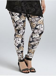 """<p>Well, looks like the cat's out of the bag! We've got the most purr-fect graphic leggings. Adorable cat graphics are printed allover, and the stretchy scuba-like fabric is super comfy. Call us a crazy cat lady, but we are totally obsessed with these!</p>  <ul> <li>31"""" inseam</li> <li>Polyester/spandex</li> <li>Wash cold, dry low</li> <li>Made in USA plus size legging</li> </ul>"""