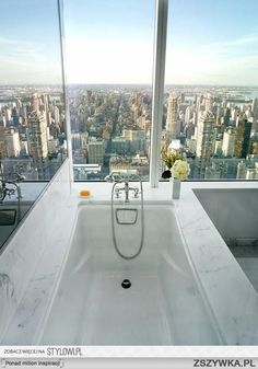 Home design / interior design ideas for amazing and beautiful bathrooms / powder rooms Modern soaker tub / bathtub with city view, white Marbel, floor to ceiling glass windows