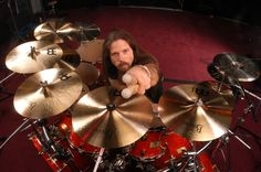 I suck at drums, but when I play, I make horrible attempts to play like him...Chris Adler of Lamb of God