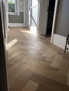Oak Engineered wood blocks laid in a Herringbone design.