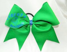 This bow measures 8.5 inches wide and 7 inches tall with a ribbon width of 3 inches. All ends have been heat sealed for fraying resistance. The bow is attached to a black pony tail holder.