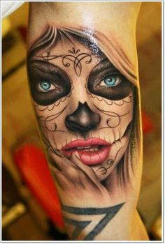 Day of the dead tattoo with very detailed mouth and blue eyes