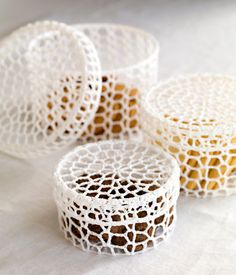 So easy.  Start with crocheting like my candle holders.  Soak in starch and let dry on the glass to shape.  Slightly larger glass for lid.