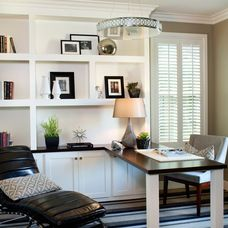 Cabinets continue under the desk so as not to lose  storage. Avalon Shutters, Inc.