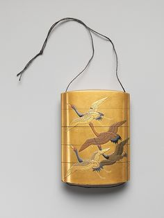 Case (Inrō) with Design of Seven Cranes in Flight  Period:Edo period (1615–1868) Date:18th–19th century Culture:Japan Medium:Lacquer, fundame, gold, silver, black and red hiramakie, gold foil; Interior: nashiji and fundame Dimensions:3 5/16 x 2 3/8 x 7/8 in. (8.4 x 6 x 2.2 cm)