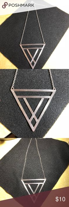 Silver tone Triangle Necklace What a neat find!!! If your into triangle and statement necklaces this piece is for you!! Jewelry Necklaces