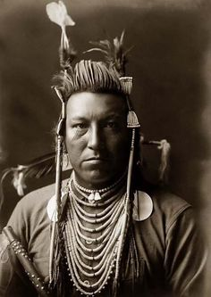 Swallow Bird, a handsome Crow Indian in Montana. It was taken in 1908 by Edward S. Curtis.