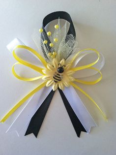 not this style- but a hairbow with that bee patch would be cute Bumble Bee Baby Shower Favors via Etsy
