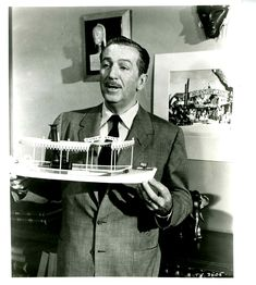 The first photograph is of Walt Disney holding a model of a Jungle Cruise launch with the concept artwork for the entrance to Adventureland in the background and some African masks and an elepahnt model sitting on the shelf. I believe this image is from Disneyland: A Progress Report/Natures Half Acre shown on television in 1955.