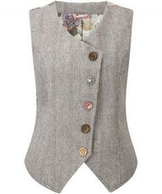 """Great kooky look with beautiful oriental style lining and mis-matched buttons. Give it a funky layered look with our Terrific Tailored Blazer and jeans. Approx Length: 60cm Our model is: 5'9"""""""