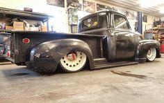 1947 1948 1949 1950 1951 Chevy Advanced Design pickup truck slammed on artillery style modern wheels in a patina black finish.