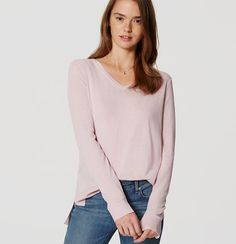 In a luxe cashmere-inspired knit, this understated V-neck is a dreamy level of soft. V-neck. Long sleeves. Side slits. Ribbed neckline, cuffs and hem.