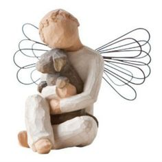 The Angel of Comfort is the only Willow Tree angel to be male. It is a small boy, with wire wrapped wings, holding tightly in his arms a chocolate brown dog. It's a beautiful remembrance piece, or a g