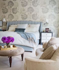 Large-scale floral wallpaper by Ted Tyler wraps this space in soft blue serenity - Traditional Home®    Photo: Joe Standart