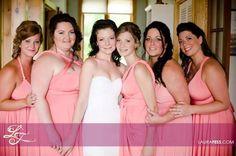 Bridesmaids wearing Henkaa's Sakura Convertible Dresses in Peach-Pink Coral. www.henkaa.com