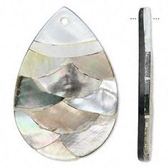 Focal, resin/mother-of-pearl shell/black lip/golden lip shell, black, 40x28mm inlaid teardrop. Sold individually.