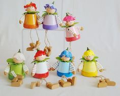 Clay pot fairies.  Could be DIY.