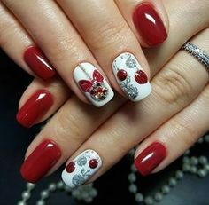 Pretty Christmas nail art. Winter nail design trends. Red and white