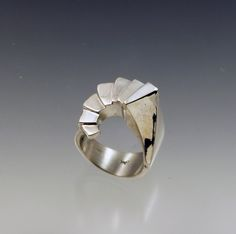 This is a stunning ring of sterling silver... I hand-carved the wax in the form of a spiral staircase... then had it lost wax cast in silver. Really special and lovely. When you order, please specify your ring size!