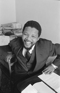Icons ©: [{Credit: Michael Peto/© University Of Dundee, The Peto Collection}]:- Nelson Mandela at the North London home of Oliver Tambo in two months before he was arrested and imprisoned.