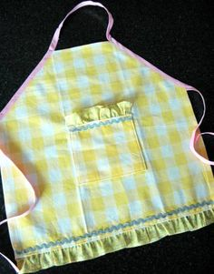 use dish towels to make kid aprons!