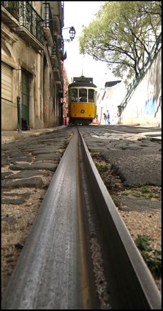 Lisboa yellow tram - old district in Portugal Places In Portugal, Visit Portugal, Spain And Portugal, Portugal Travel, Lisbon Tram, Places To Travel, Places To Go, Train Tracks, The Good Place