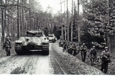Armour and infantry on a forest track