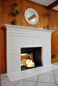 white brick fireplace w/ candles