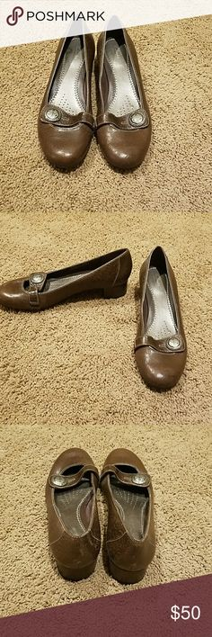 Closed toe Clark's Artisan pumps Closed toe, Clark's Artisan brown pumps with strap.  Never worn. Clarks Shoes Flats & Loafers