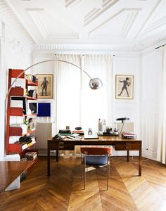 Eclectic office in Paris with arched chrome floor lamp and red accents on @thouswellblog