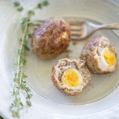 Gluten free quail scotch eggs wrapped in savory, herb sausage for the perfect bite sized snack